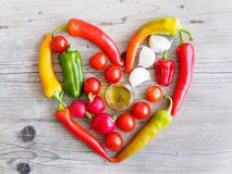 Vegetables in heart shape, top view royalty free stock images