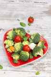 Vegetables in heart shaped plate Stock Photography