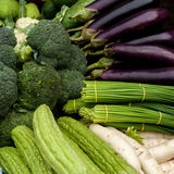 Vegetables and herbs at asian market Stock Images