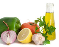 Vegetables, herbs, lemon anf olive oil Royalty Free Stock Image