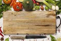 Vegetables, herbs, spices and empty cutting board Royalty Free Stock Images