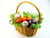 Vegetables and herbs in a wicker basket Royalty Free Stock Photography