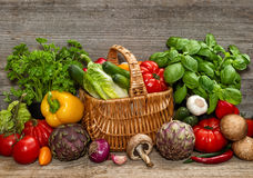 Vegetables and herbs on wooden background. Food ingredients Stock Photo