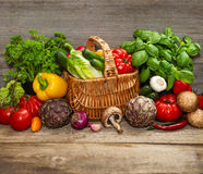 Vegetables and herbs on wooden background Stock Photography