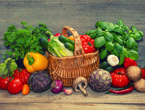 Vegetables and herbs on wooden background. raw food ingredients Royalty Free Stock Image