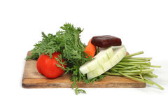 Vegetables on hopping block Royalty Free Stock Image