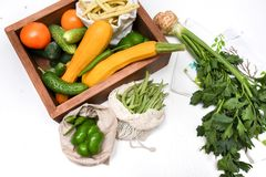 Free Vegetables In White Eco Bags, Sacks And A Wooden Storage Box. Tomatoes, Peppers, Zucchini, Cucumbers, Beans. Zero Waste Royalty Free Stock Images - 162173189