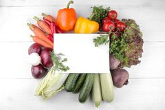 Vegetables including lettuce cucumber cabbage onion pepper beetroot carrot zucchini and tomatoes with a blank for recipes royalty free stock images