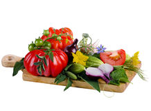 Vegetables isolated on white background. Tomatoes, cucumbers and onions on a wooden board Royalty Free Stock Photo