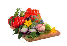 Vegetables isolated on white background. Tomatoes, cucumbers and onions on a wooden board Royalty Free Stock Photos
