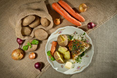 Vegetables, jacket potatoes, and roast chicken Royalty Free Stock Photo