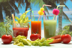 Vegetables juice on the beach Stock Photo