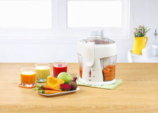 Vegetables juice blender machine in kitchen interi Royalty Free Stock Photo