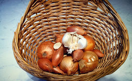 Vegetables in the kitchen: onions of different shapesand garlic Stock Photos