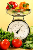 Vegetables on kitchen scale Royalty Free Stock Photo