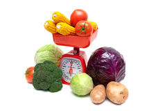 Vegetables and kitchen scales on a white background Stock Photo