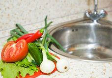 Vegetables on kitchen sink Royalty Free Stock Photo