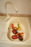 Vegetables in the kitchen sink Royalty Free Stock Photos