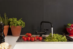 Vegetables In The Kitchen Sink. Washing vegetables in the kitchen sink royalty free stock images