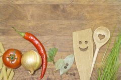 Vegetables and kitchenware on cutting board Royalty Free Stock Images