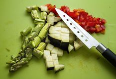 Vegetables and knife. An image of cutted vegetables in a table with a knife royalty free stock image
