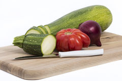 vegetables and knife on board Royalty Free Stock Images