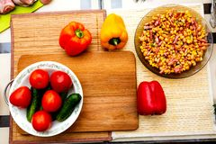 Vegetables laid out on the kitchen table royalty free stock photography