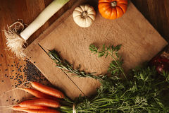 Vegetables and lentils on an old cutting board Stock Images
