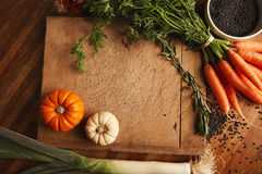 Vegetables and lentils on an old cutting board Stock Photo