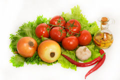 Vegetables - lettuce, onion, garlic,chilli pepper, tomatoes and Royalty Free Stock Photography