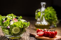 Lettuce salad with tomatoes onion cheese and olives stock images