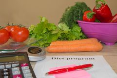 Vegetables, Libra, calculator and centimeter on a white background. Diet concept. Diet for weight loss Royalty Free Stock Photo