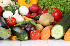 Vegetables like tomatoes, paprika, lettuce and carrots Stock Photos