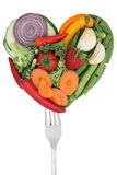 Vegetables love heart on a fork Stock Images