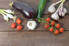 Vegetables are lying on a wooden table. Royalty Free Stock Photo