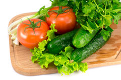 Vegetables. Many vegetables on wooden board Stock Images