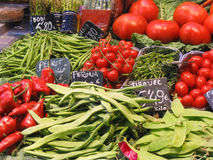 Vegetables at the market. Fresh beans and tomatoes at the market Stock Image
