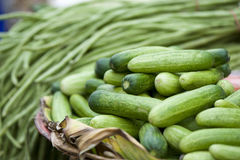Vegetables on market. Cucumbers and beans for sale on a market Stock Photography
