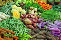 Vegetables on market in india. Heap of various vegetables on market in asia Stock Images