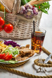 Vegetables and meat kebab served with fries and a Coke Stock Photography