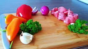 Vegetables and meat on a plateau royalty free stock image