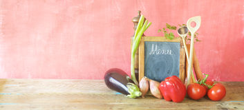 Vegetables and menu black board Stock Photos