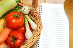 Vegetables and menu book Royalty Free Stock Photos