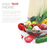 Vegetables in metal colander over white Stock Images