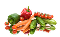 Vegetables on the mirror surface. white background. Stock Photography