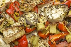 Vegetables mix baked in the oven with aubergine, red bell pepper, leek, basil and olive oil. Stock Images