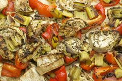 Vegetables mix baked in the oven with aubergine, red bell pepper, leek, basil and olive oil. Royalty Free Stock Photos