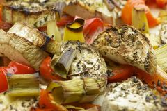 Vegetables mix baked in the oven with aubergine, red bell pepper, leek, basil and olive oil. Royalty Free Stock Photo