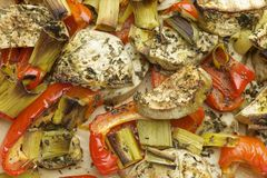 Vegetables mix baked in the oven with aubergine, red bell pepper, leek, basil and olive oil. Stock Image