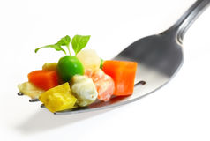 Vegetables mix on fork